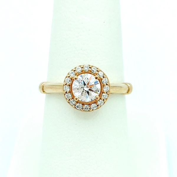 round brilliant cut diamond halo engagement ring in rose gold