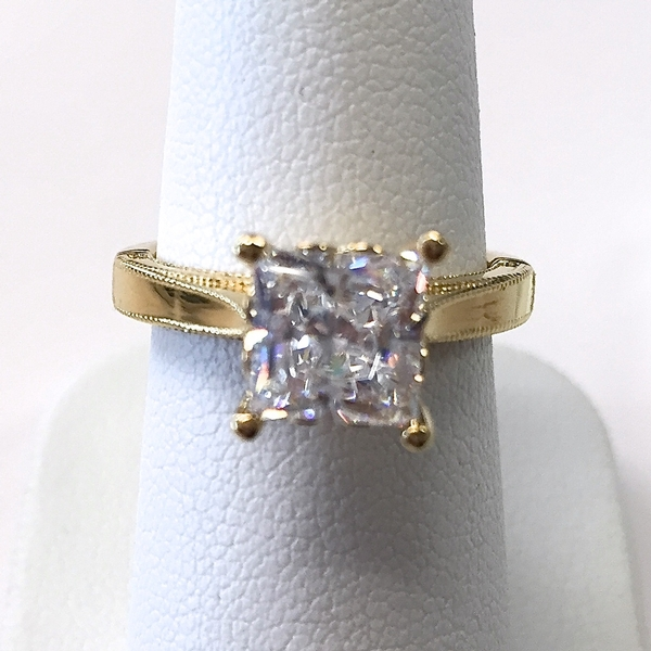 Princess cut diamond and yellow gold ring