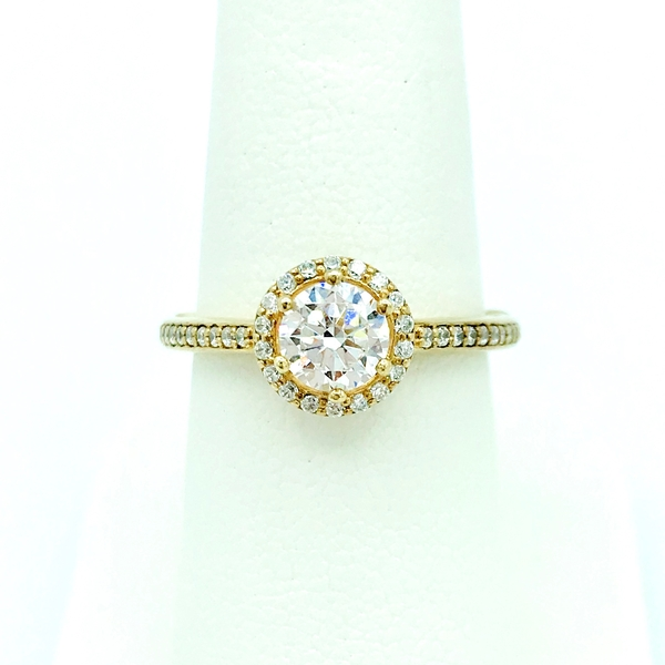 round brilliant cut diamond halo engagement ring with accent diamonds
