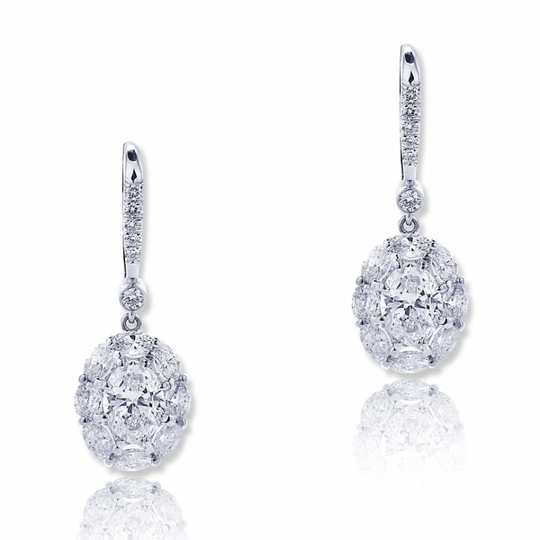 Dazzling diamond drop earrings featuring GIA certified oval diamonds in center surrounded by oval diamonds and hung my micro pave.jpg