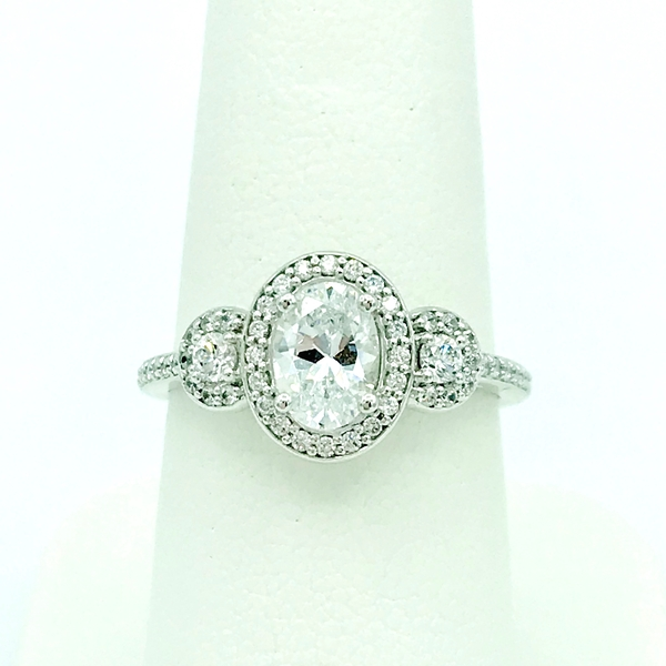 three stone oval and round halo diamond engagement ring