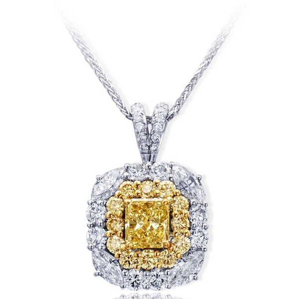 1.23 ct. radiant fancy yellow diamond encircled by round fancy yellow diamond and white marquise and round diamonds. Handcrafted in platinum and 18KY gold.jpg