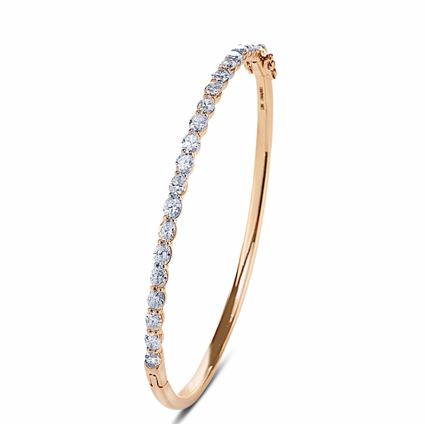 diamond bangle featuring perfectly matched oval diamonds in a shared prong setting.jpg