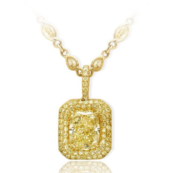 fancy light yellow diamond pendant featuring a striking 3.83 ct. GIA certified cushion cut fancy light yellow diamond edged with round fancy yellow diamond pave.jpg