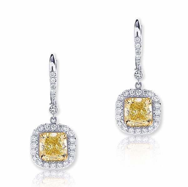 fancy yellow diamond drop earrings featuring 2 fancy yellow GIA certified radiant-cut diamonds surrounded by micro pave.jpg