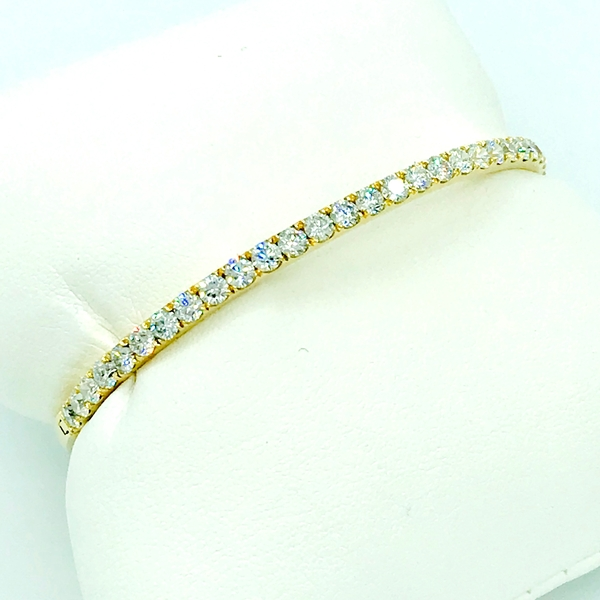round brilliant cut diamond and yellow gold bangle bracelet