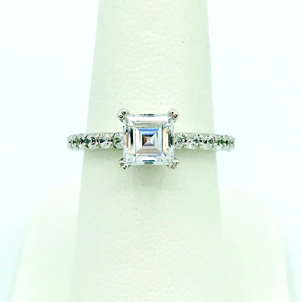 princess step cut engagement ring with accent round brilliant cut diamonds