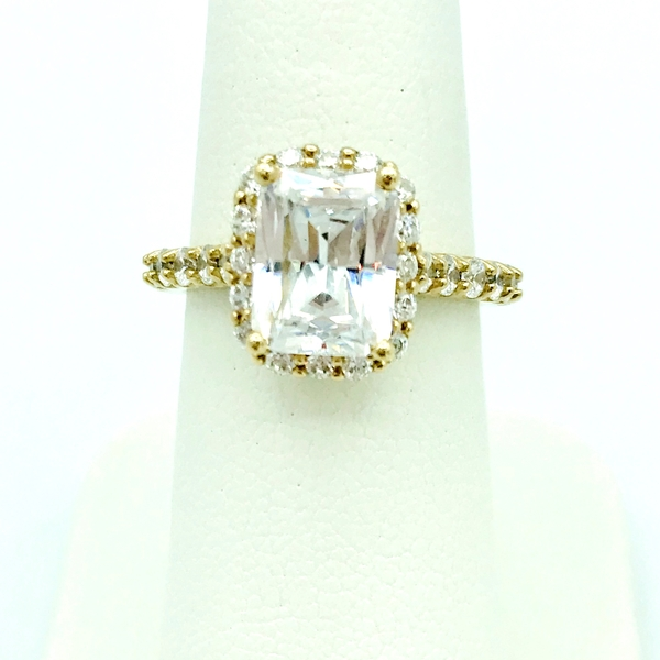 radiant cut diamond and yellow gold halo ring with accent diamonds