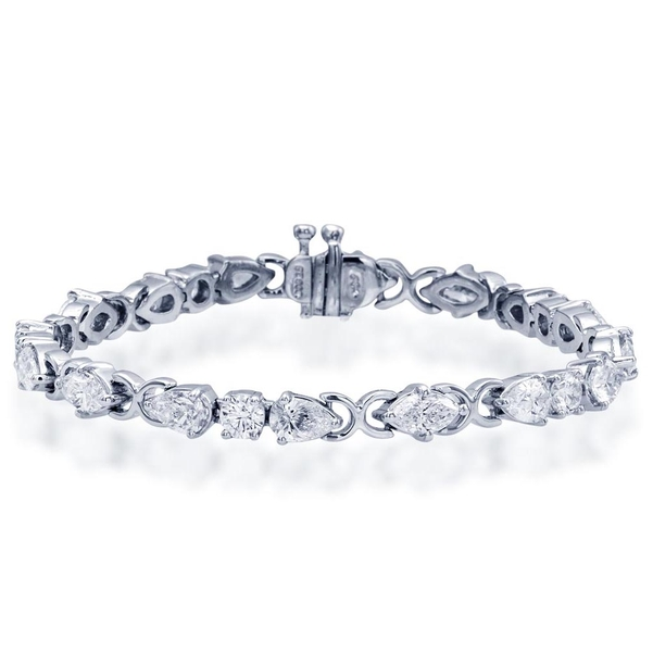 single row bracelet features, individually selected, 10 pear shaped, 6 marquise and 5 round diamonds handcrafted in pure platinum.jpg