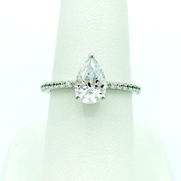 pear shape diamond engagement ring with accent diamonds
