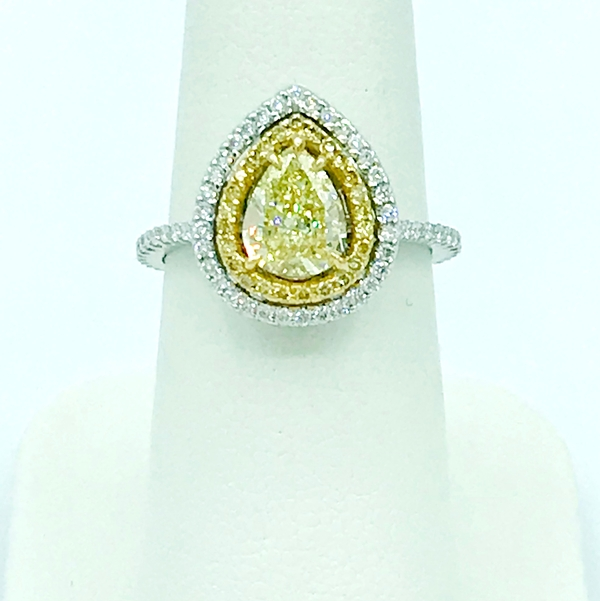 fancy yellow oval diamond halo yellow and white gold ring