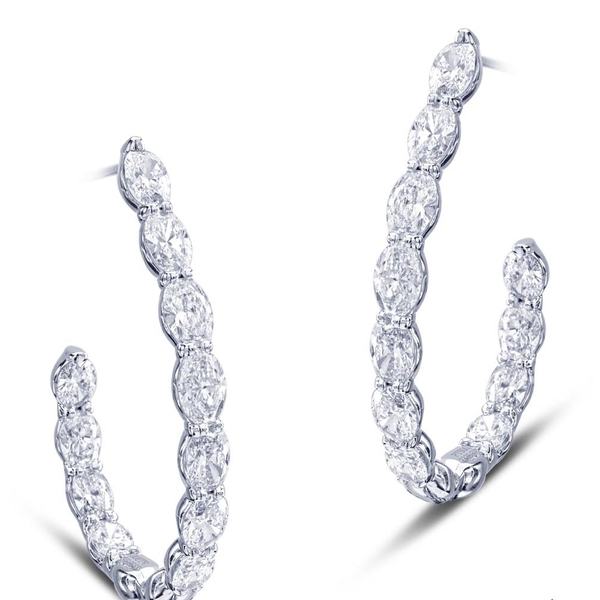 hoop earrings featuring 22 oval diamonds in a shared prong setting.jpg