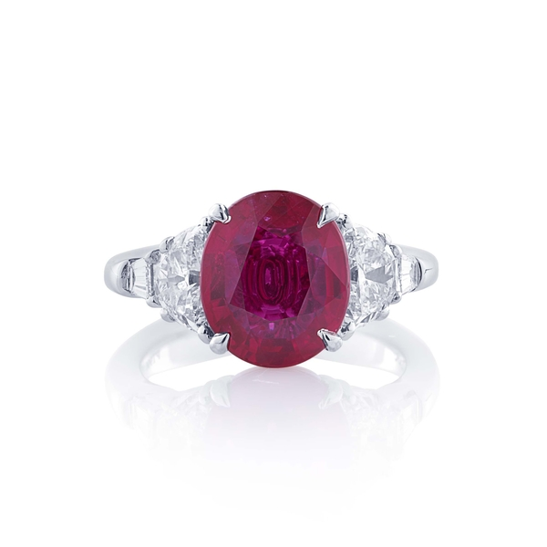4.44 oval ruby Mozambique and diamond ring.jpg