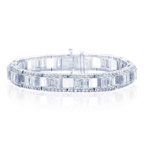 platinum bracelet is uniquely designed with perfectly matched emerald-cut diamonds set in a track of round diamonds.jpg