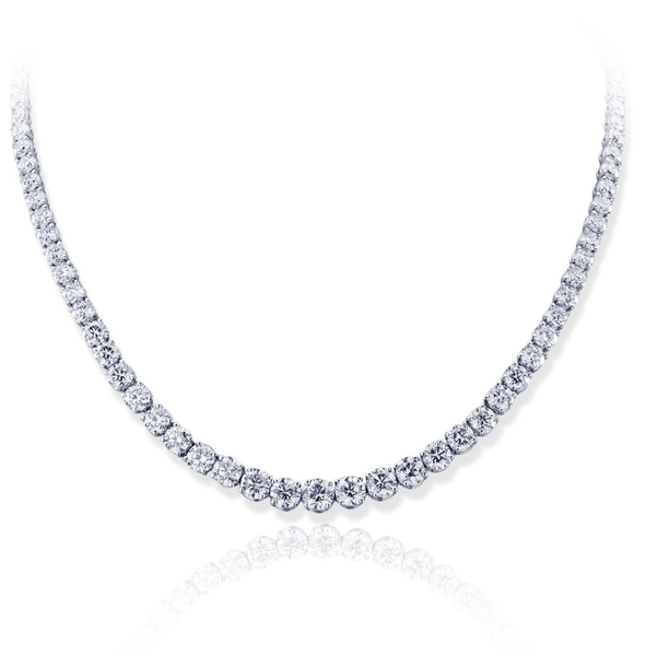 diamond necklace featuring a round GIA certified center accompanied by additional brilliant round diamonds in a shared prong setting.jpg