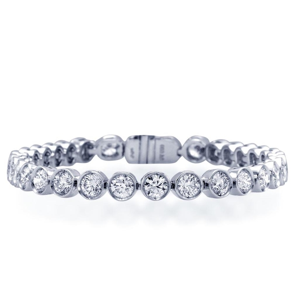 Diamond bracelet in a classic straight line style with 32 round diamonds bezel set in platinum.jpg