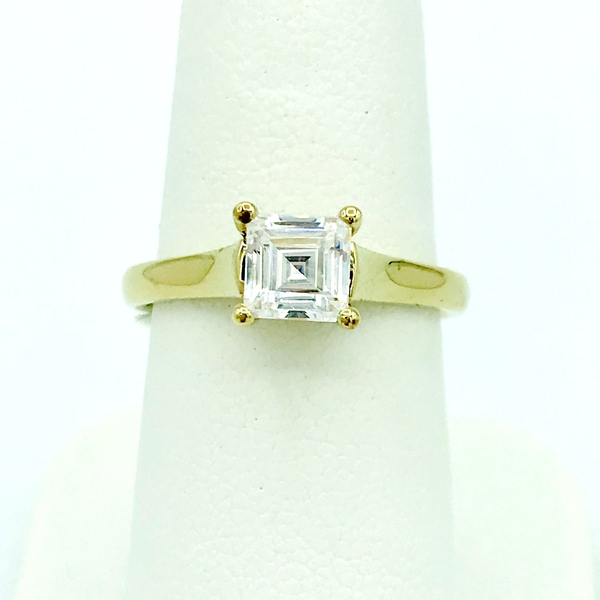 princess step cut diamond solitiare and yellow gold engagement ring