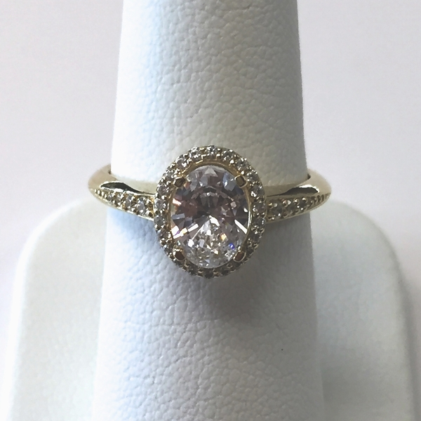 Oval halo yellow gold diamond ring