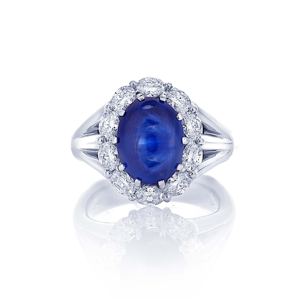 7.38 no-heat oval cabochon sapphire and diamond ring.jpg