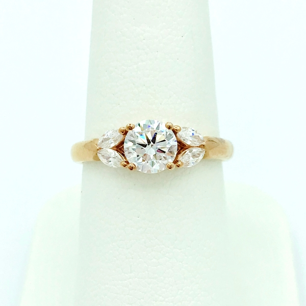 round brilliant cut diamonds and rose gold ring with four marquise diamonds